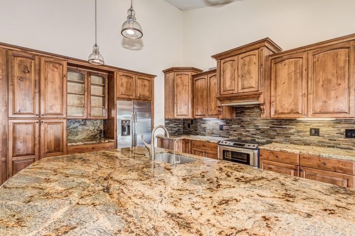 High end cabinets and large Kitchen island