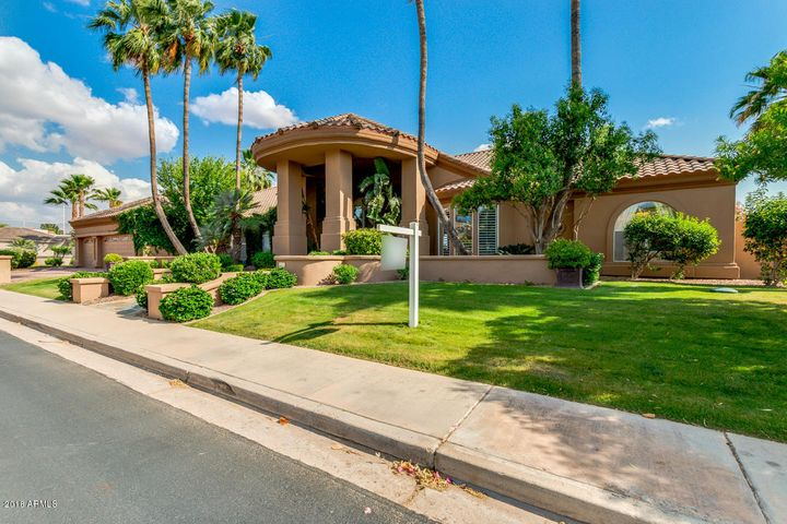 Magnificent Curb Appeal with Lush Landscaping and Mature Trees!