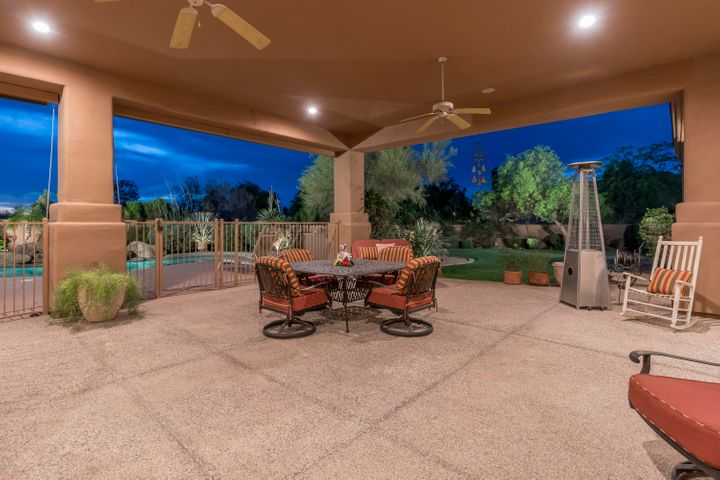 The huge covered patio allows for comfortable gatherings. Currently fenced from the pool area ~ fence can easily be removed.