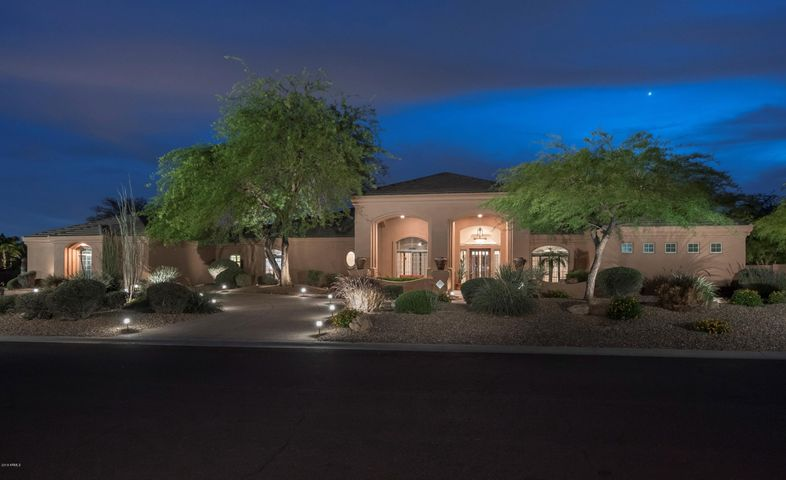 Fabulous curb appeal ~ convenient circular drive plus a 4-car garage!