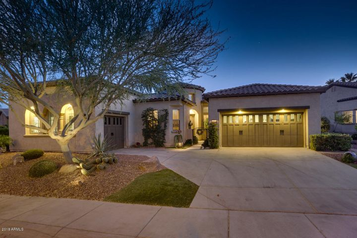 """Outdoor lighting says """"Welcome Home"""" come see this home today."""