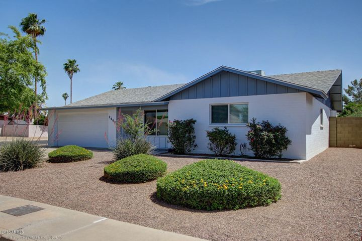 Welcome home to your North facing corner lot, in the highly sought after Tempe neighborhood of Optimist Park