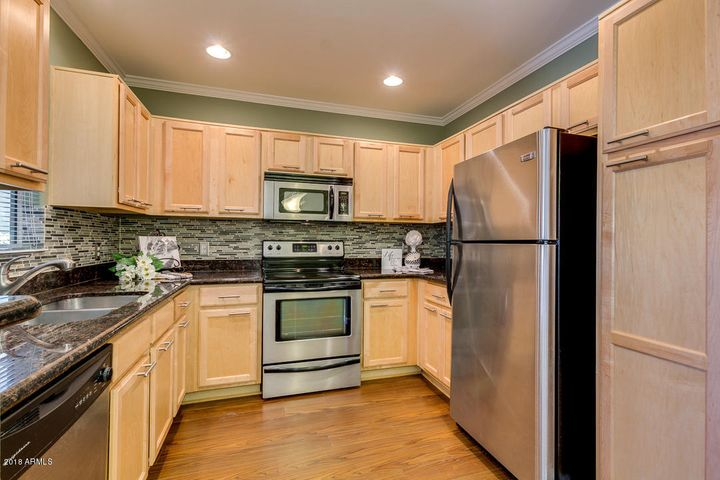 Stylish UPDATED Kitchen with generous storage & STAINLESS appliances!