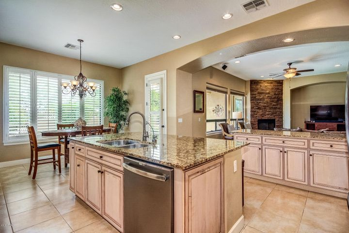 Open Concept with Kitchen opening to Living Room. Perfect for entertaining. French Door to Pool Area.