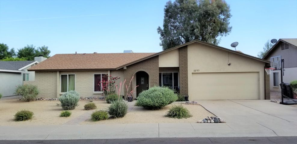 Cozy home with low maintenance desert landscape centrally located