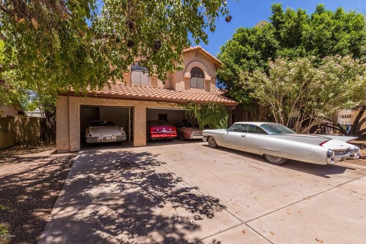 Three car garage w/working doors - collectors cars too long for door to shut