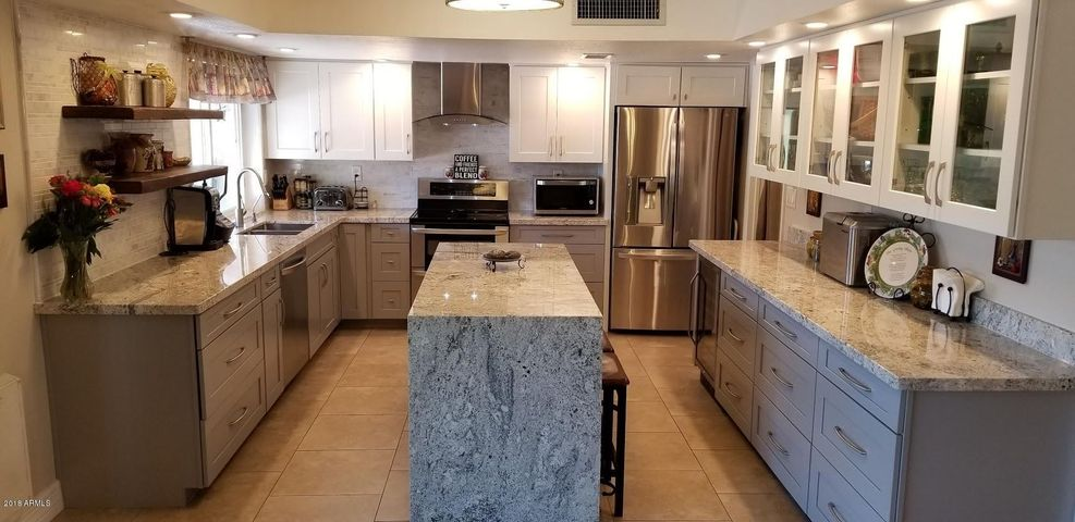 Beautiful remodeled Kitchen with granite countertops , newer cabinets and Appliances