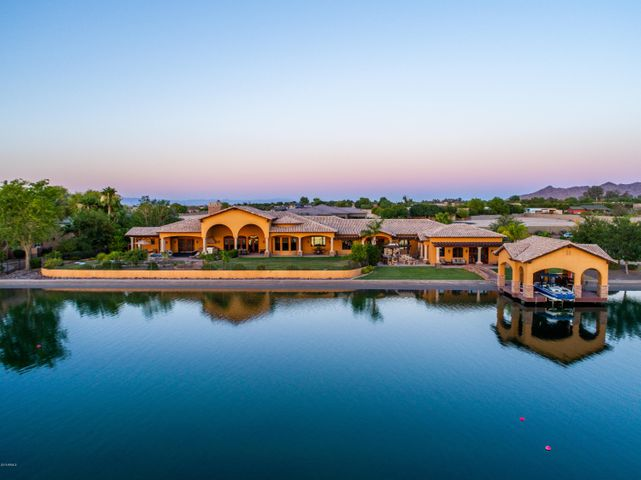 A rare opportunity to own a beautiful custom home in San Tan Lakeside Estates.