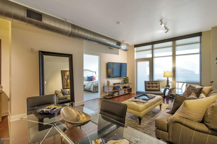 Nearly-new gently-used contemporary furnishings from Living Spaces are included.