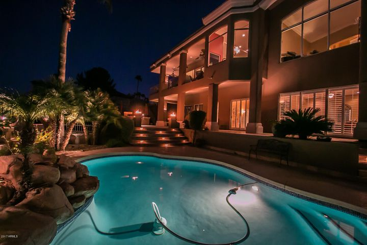 night view back of home and pool