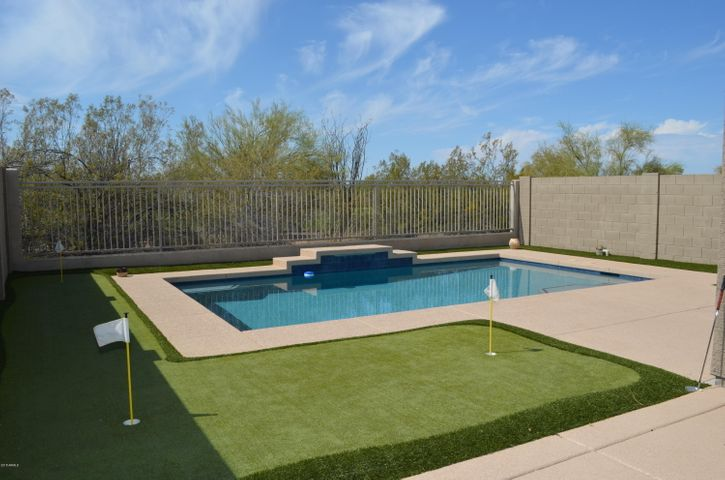 What a great entertaining back yard complete with a new pool and putting green with artificial turf. Easy care and lots of fun.