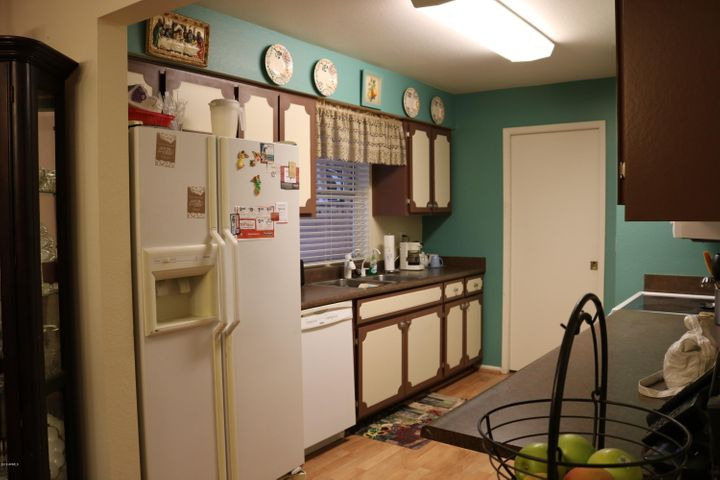 Cute galley kitchen with recent paint