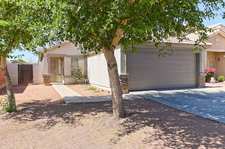 Corner lot features tree and low maintenance landscaping. The exterior of the home has recently been painted too!