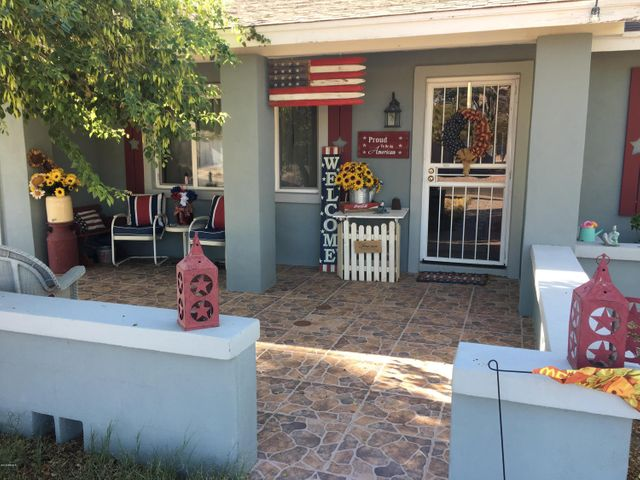 This charming front porch welcomes you home!