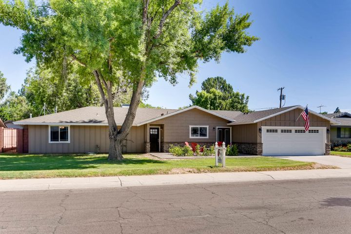 Welcome to this updated and expanded North Central Phoenix 2,753sf 5 bed/3 bath ranch home.