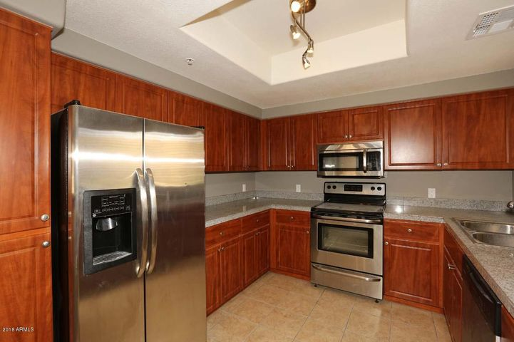 Kitchen with Stainless appliances, granite counters and lots of cabinets & pantry