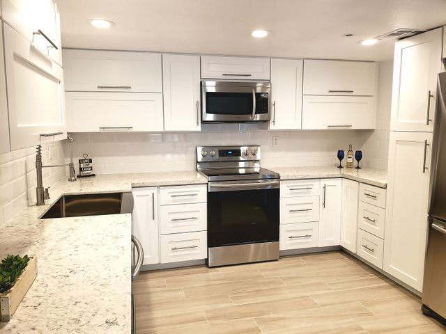 Open and wide kitchen includes all SS appliances, farm style SS sink, French door Refrigerator and B/I pantry.
