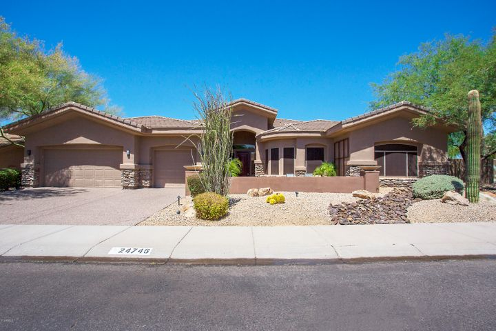 Beautiful Executive home with gated paver entry courtyard