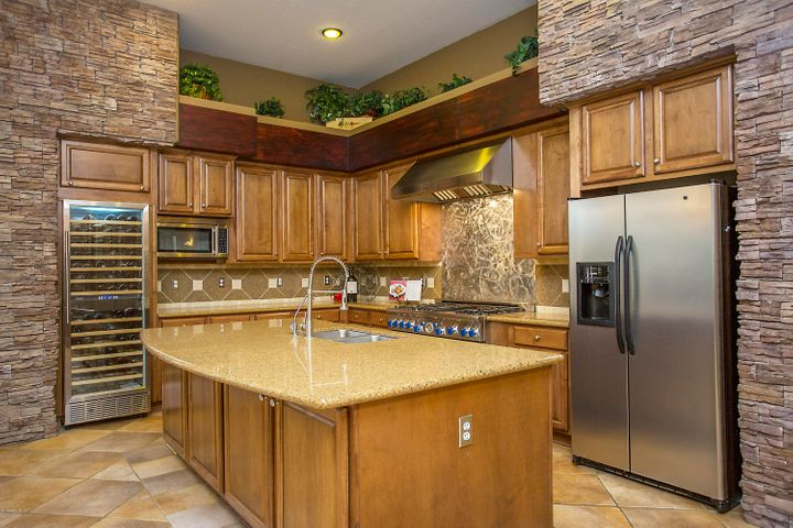 Do you collect wine? Hold your best in this 168 bottle chiller in your gourmet kitchen with Pro-Series dual oven stove and art work backsplash.