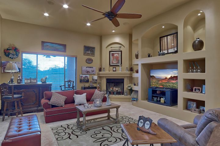 Custom home features such as niches for artwork, accent lighting and honed Travertine floors.