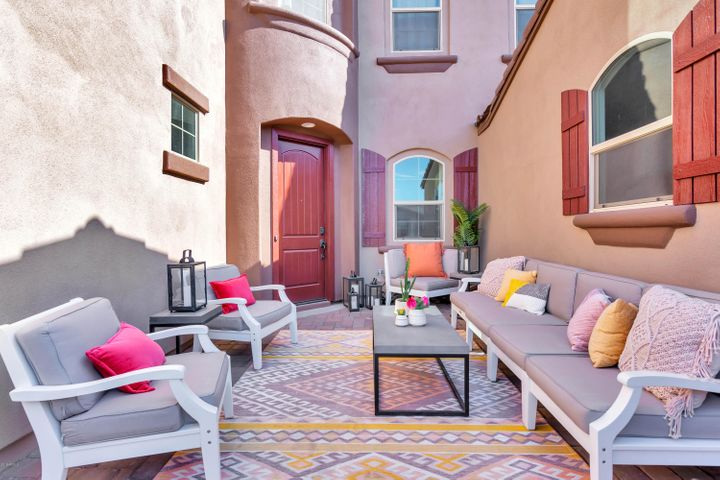 Sellers created another living space with half wall & pillars for courtyard relaxing....