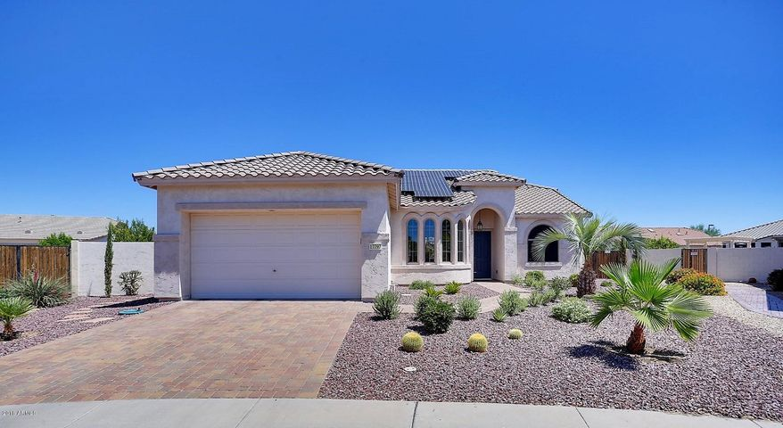 Welcome to 17797 N. Johns Court, Surprise! This lovely heated pool home is nestled on a N/S facing oversized lot in the guard gated active adult community of Arizona Traditions.
