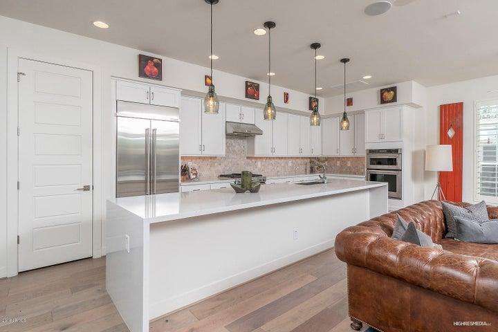 Chef's Kitchen with Stainless Steel Kitchen Aid appliances.