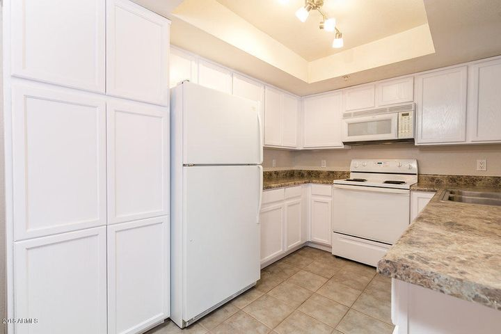 Bright white kitchen cabinets with white matching appliances