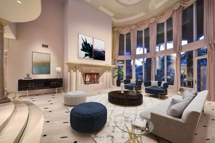 Airy grand salon with gas fireplace, built in speakers and multiple exits to patio (virtually staged photo)