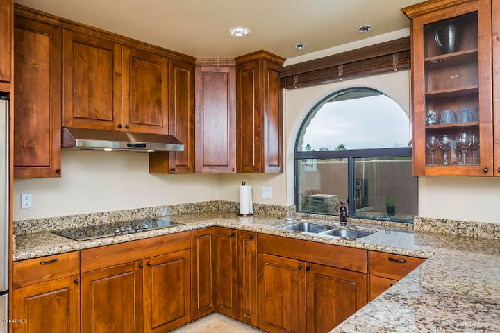 Quality granite counter tops and Alder cabinets