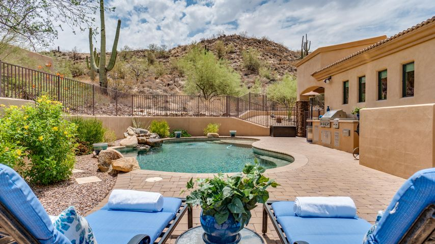 This home sits on 1.66 acres of privacy. The hill behind the pool area is part of this gorgeous hillside home.