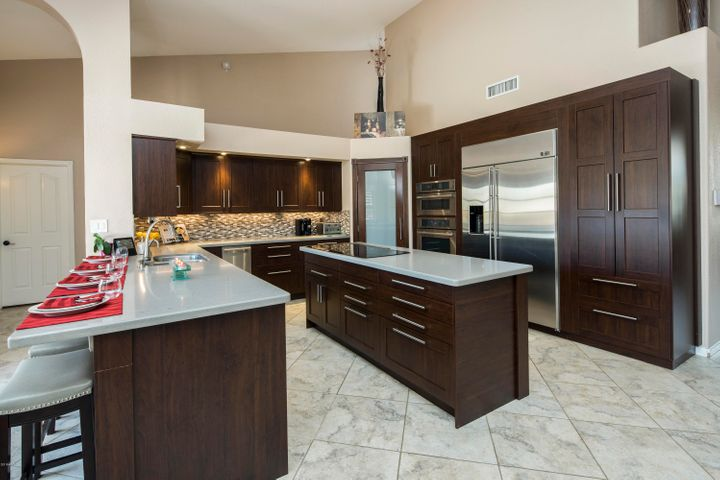 High-end stainless steel appliances and quartz countertops