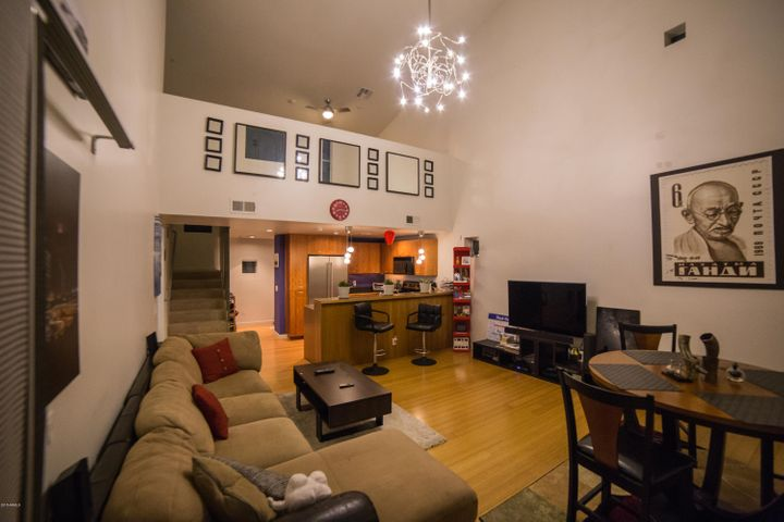 Entertain or Relax in this Beautiful Living Room with Soaring Ceilings