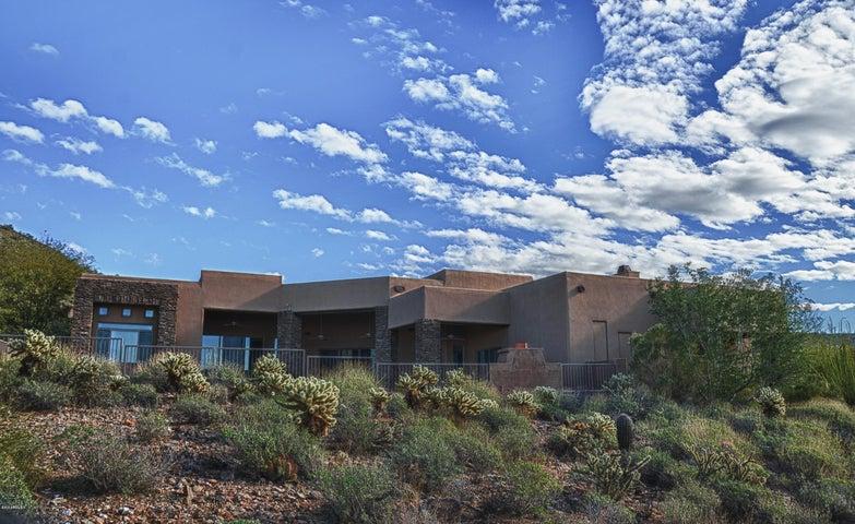 Desert landscaping, inviting patios and beautiful skies.