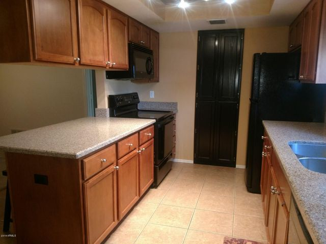 Electric Range, Microwave, Dishwasher and Refrigerator included