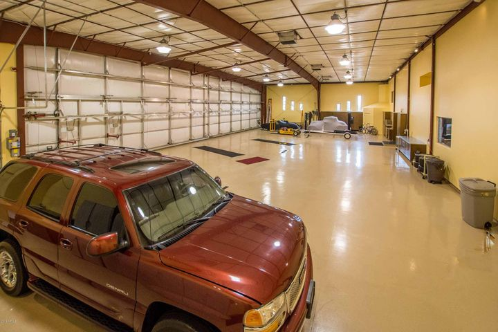 A cavernous airplane hangar attached to this contemporary home. And not just for airplanes, for all your toys. The home is also on a championship golf course, in addition to a gated and secure private airpark runway.