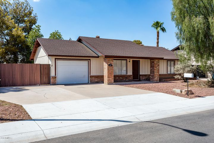 Oversized 3-car driveway with new RV gate and walk-through gate.
