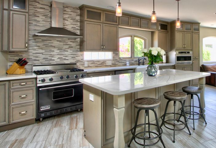 Open concept kitchen with custom cabinets & top of the line finishes.