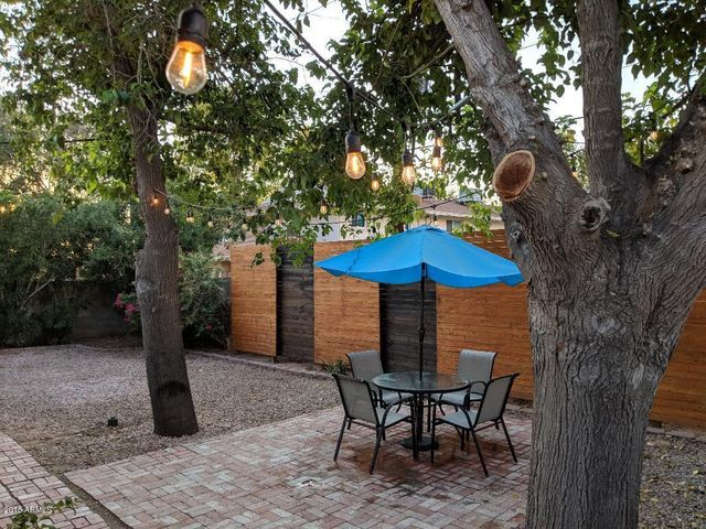 BACK YARD GREAT FOR ENTERTAINING UNDER THE TREES!