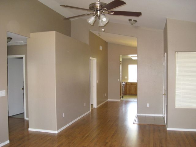 Neutral two-tone paint and vaulted ceilings make this home bright and spacious