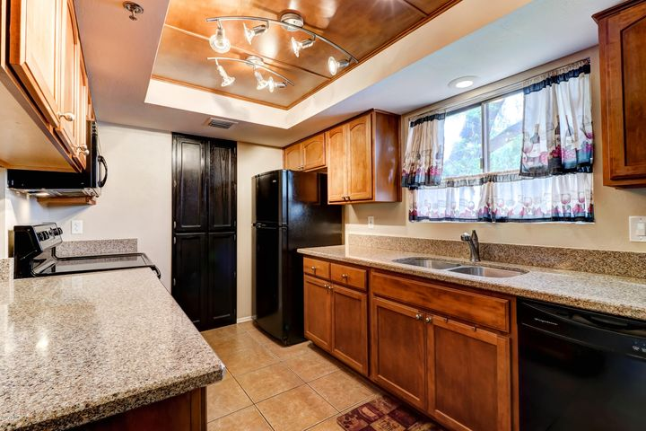 Granite Countertops, track lighting, black appliances