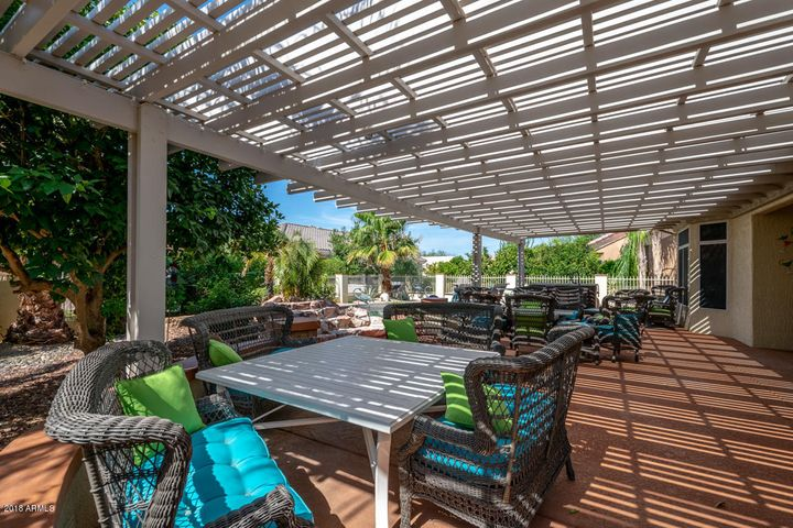 Backyard oasis with expansive Pergola covered patio with misters and new cool decking!