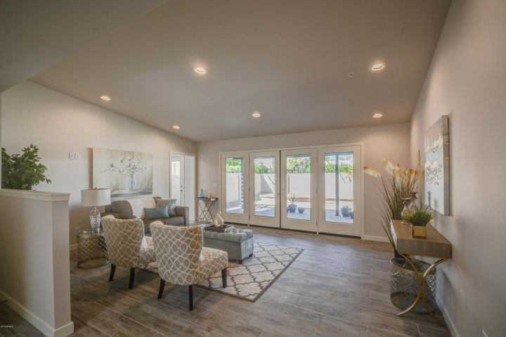 Light and Bright Family Room with Vaulted Ceilings and 12 Ft French Doors