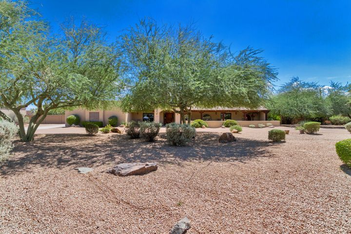 This magnificent home has Great Curb Appeal on this quiet Cul de Sac lot. Lush desert landscaping with mature trees & bushes. Very easy maintaining this yard