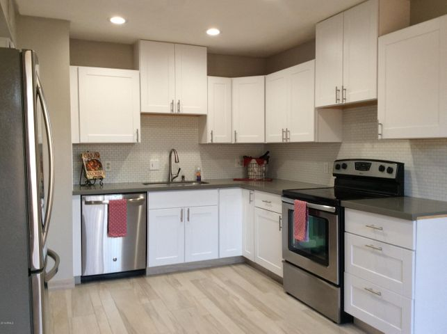 New kitchen features SS appliances and Quartz countertops.