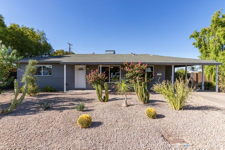Welcoming curb appeal! Professionally landscaped front yard.