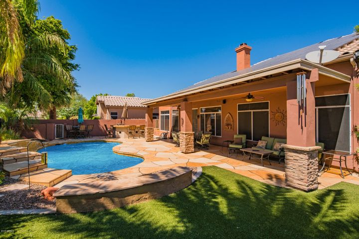 Beautiful backyard with built in BBQ, extended patio, turf