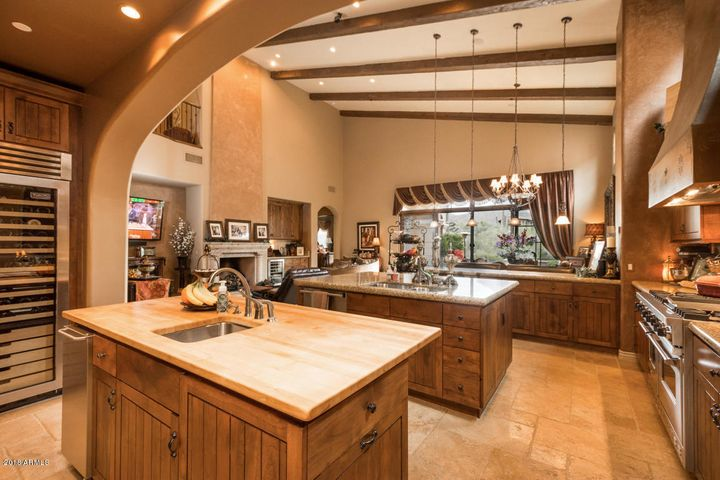 The well appointed kitchen boasts Viking appliances, double islands and a full size wine refrigerator.