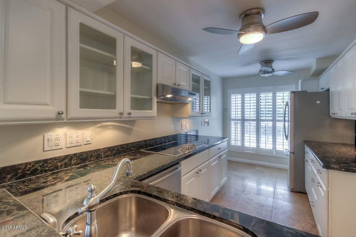 Stunning kitchen with stainless steel sink and appliances, ceiling fans