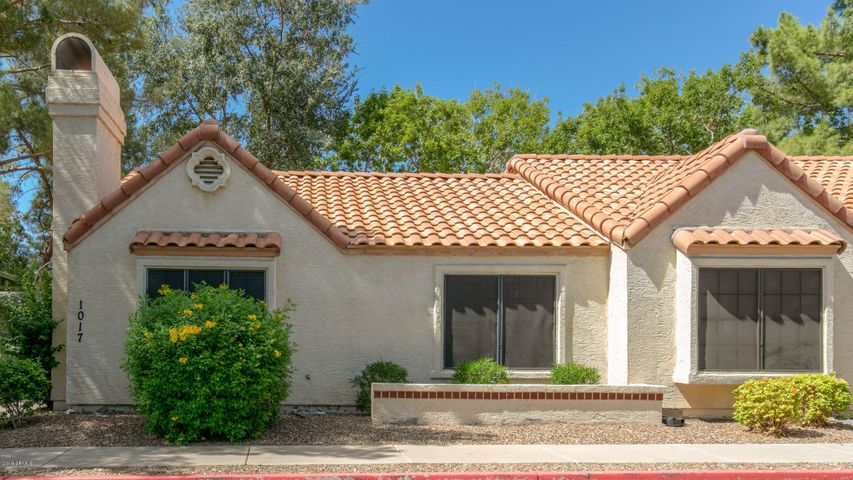 End unit offers close guest parking right by the front door & privacy behind.